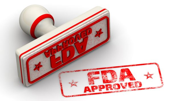 "Red seal and imprint ""FDA APPROVED"" on white surface. FDA - Food and Drug Administration is a federal agency of the United States Department of Health and Human Services."