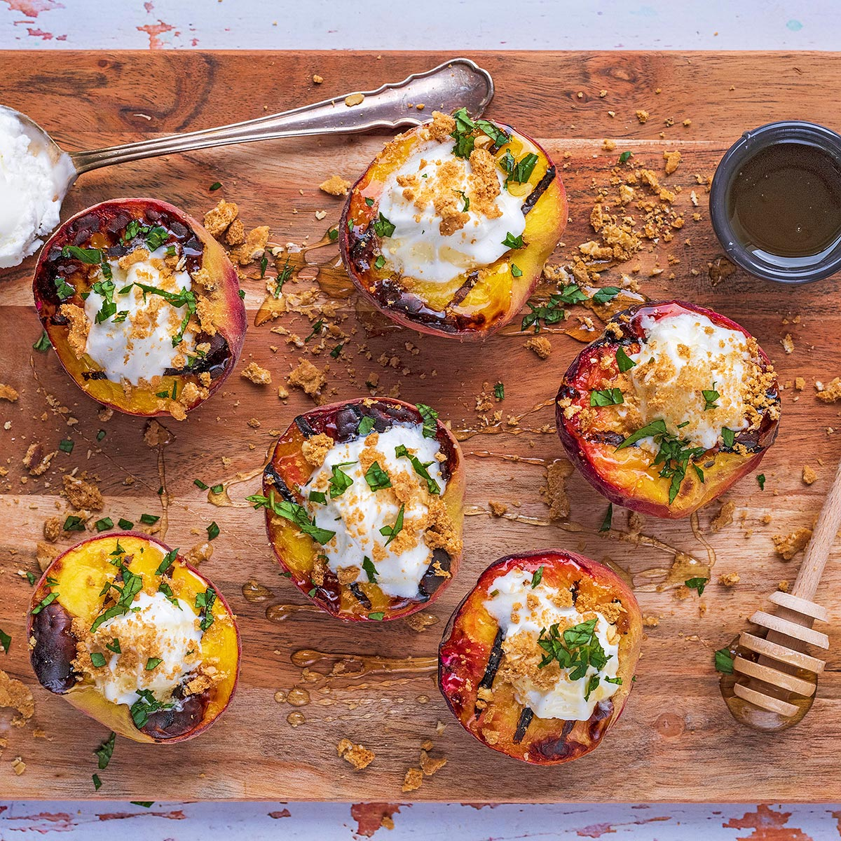 Carve out a Few Minutes to Enjoy These Grilled Peaches with Cookie Crumbles