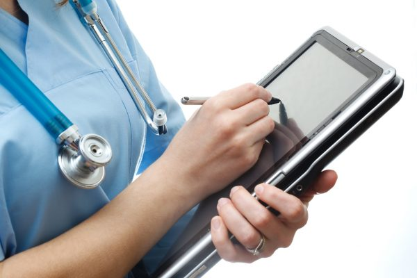 electronic health record Doctor is using tablet pc