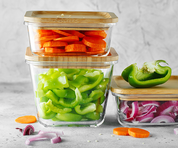 Vegetables in glass freezer containers