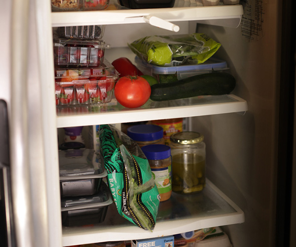 View of open fridge filled with food